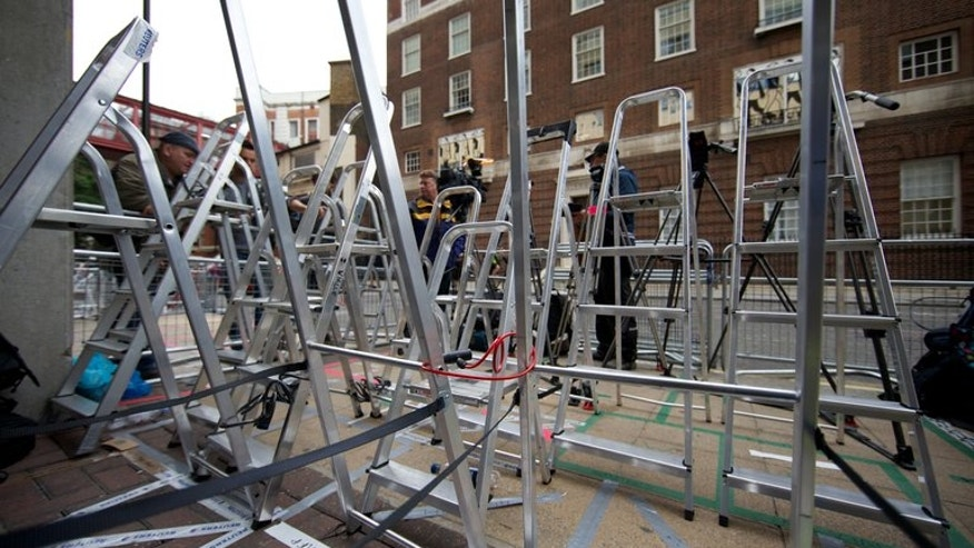 Ladders positioned to secure photographers' positions stand outside the Lindo Wing of Saint Mary's Hospital in Paddington, west London on July 2, 2013. It could be weeks before Prince William's wife Catherine gives birth to Britain's future monarch -- but the world's media, taking no chances, are already firmly camped outside her London hospital.