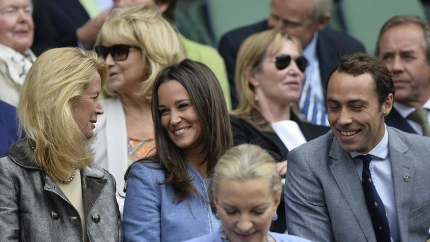Pippa (C) and James Middleton, sister and brother of Catherine, Duchess of Cambridge, watch the play at the 2013 Wimbledon Championships, on June 24, 2013. Britain's royal baby will spend a childhood mostly surrounded by the stiff grandeur of the palace, but the Middletons could offer a touch of normality.