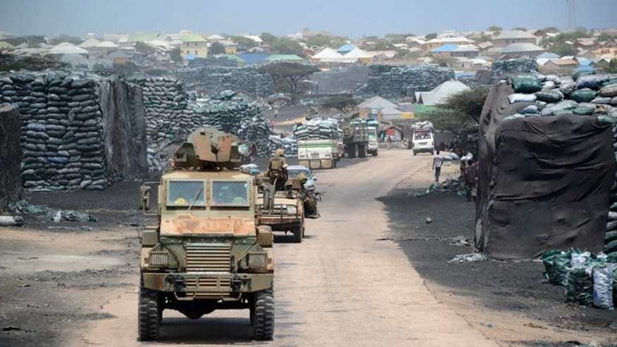 Battles between rival warlords in Somalia's key southern port city of Kismayo killed at least 71 people last month, UN officials said Friday, clashes Mogadishu has accused Kenyan troops of encouraging. Photo taken on February 27, 2013 shows Kenyan troops patrolling near Kismayo