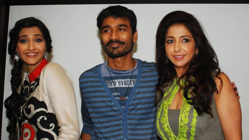 """Indian Bollywood actors Sonam Kapoor (right) and Dhanush (centre) with producer Krishika Lulla (right) attend a promotional event for the Hindi film """"Raanjhanaa"""" in Mumbai on June 20, 2013. Pakistan has banned an Indian film about the love affair of a Muslim-Hindu couple on the grounds that it could offend viewers in the conservative Islamic republic, officials said Friday."""