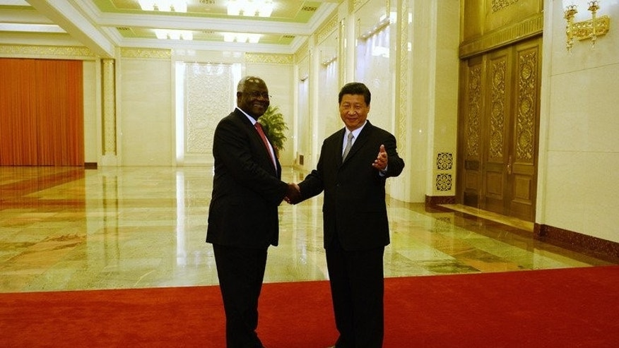 Sierra Leonean President Ernest Bai Koroma (L) meets with Chinese President Xi Jinping (R) at the Great Hall of the People in Beijing on June 26, 2013. Koroma said on Friday that he had signed deals for a new international airport, a railway and raft of other huge construction projects totalling $8 billion during a recent visit to China.