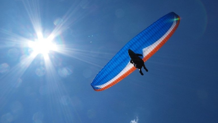 A paraglider flies near Chopok mountain in the Low Tatra mountains in Slovakia on July 10, 2010. Iran suspects them of spying, but friends of eight Slovak paragliders detained in May know them as freedom-loving adrenalin junkies who travel the world to film high-flying documentaries.