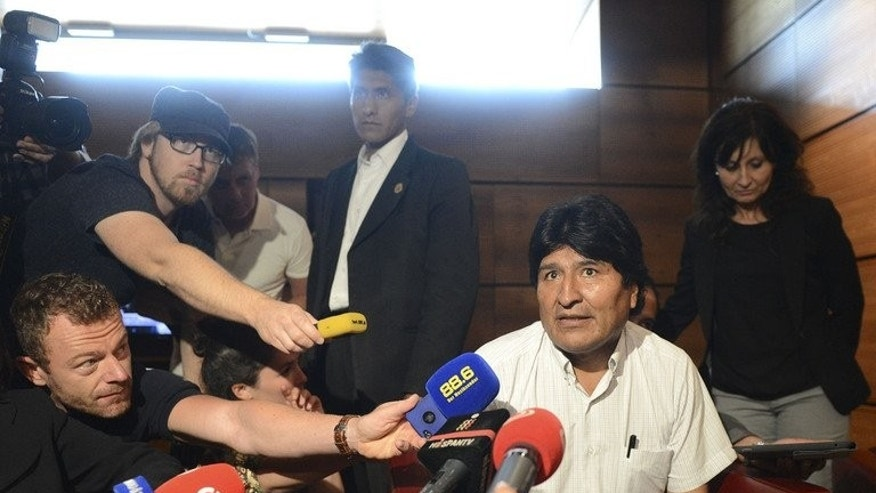 Bolivian President Evo Morales talks to journalists on July 3, 2013 at the airport of Schwechat, near Vienna. Spain said Friday it was told fugitive US intelligence leaker Edward Snowden was aboard Bolivian President Evo Morales's plane as a diplomatic storm brewed over the diverted flight.