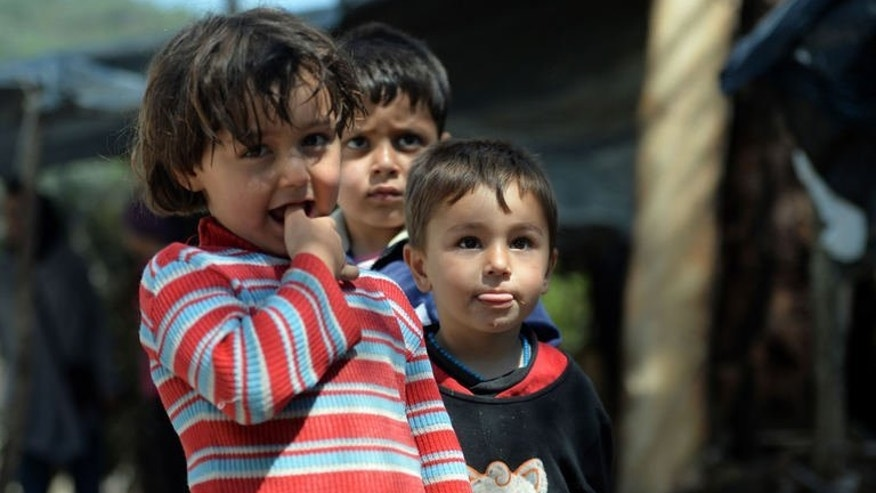 Syrian Turkmen children are seen at a makeshift refugee camp some kilometers away from the Syria-Turkey border on April 23, 2013. Last week Turkish police raided offices of two humanitarian aid missions operating in war-torn Syria and deported four foreigners, witnesses said.