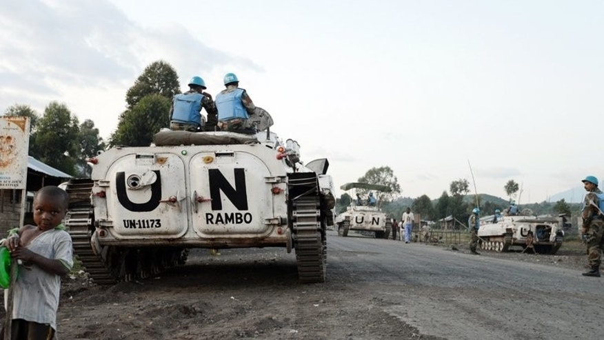 Soldiers of the UN mission in the Democratic Republic of Congo (MONUSCO) arrive in armoured vehicles in the border area near Kagnaruchinya, 7 km north of Goma, on June 2, 2013. The M23 rebellion -- launched by Tutsi former soldiers who mutinied in April 2012 -- is the latest in years of violence that have ravaged the vast central African country's mineral-rich east.