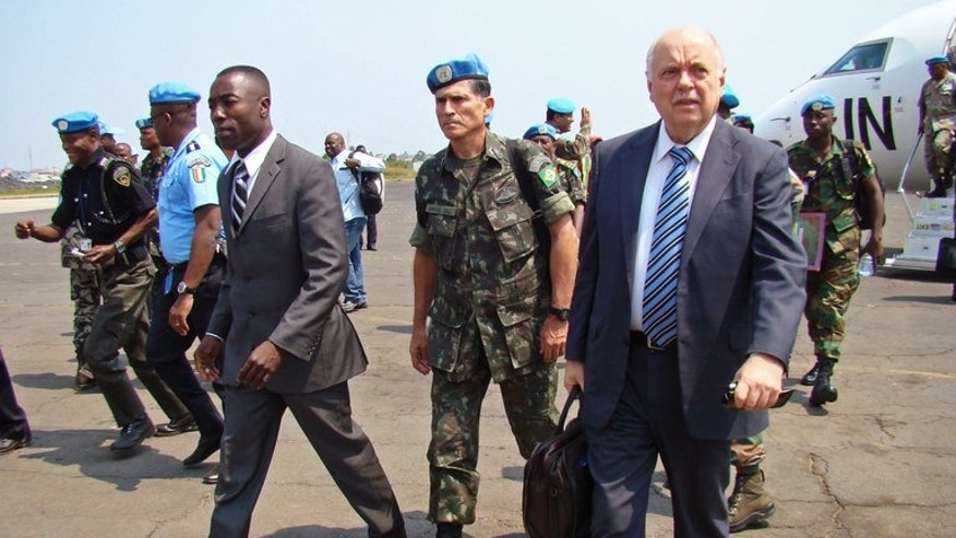 The commander of the UN Stabilization Mission in the Democratic Republic of the Congo (MONUSCO), Carlos Alberto Dos Santos Cruz (C), arrives in the eastern Congolese city of Goma, on June 11, 2013. Cruz was appointed to the position by UN Secretary-General Ban Ki-moon on May 17, replacing Indian General Chander Prakash.