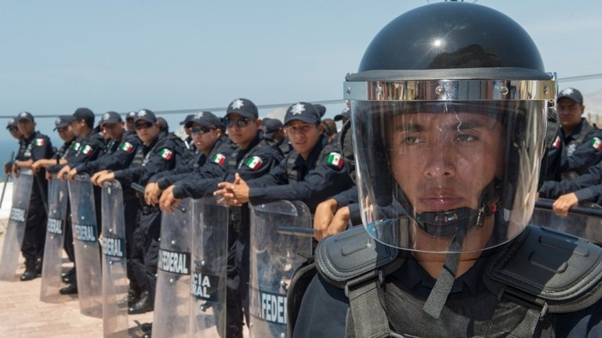 Mexican Federal Police carry out a drill on June 13, 2012, in Cabo San Lucas, Baja California, Mexico. Candidates have been killed and others threatened in campaigning ahead of local elections Sunday in Mexico -- the first voting since a new president took over with a pledge to reduce violence.