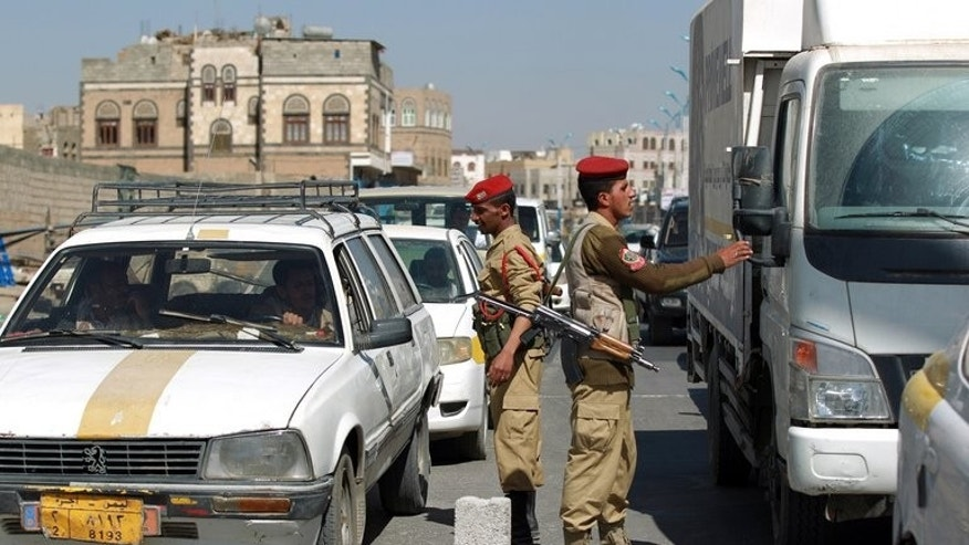 File picture shows Yemeni soldiers at a checkpoint on March 16, 2013 in the capital Sanaa. A bomb hidden in a plastic bag exploded at a checkpoint in Sanaa on Saturday, killing three policemen and wounding a fourth, a security services official said.