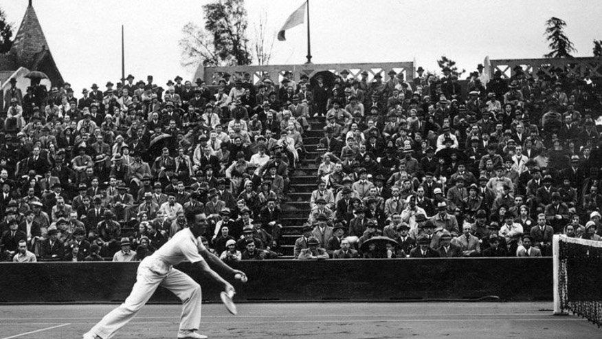 Fred Perry in action at Roland Garros stadium in Paris in the 1930s. When Fred Perry won his third and final Wimbledon title in 1936, the victory was received with muted praise and ongoing suspicion of the brash, self-confident northerner.