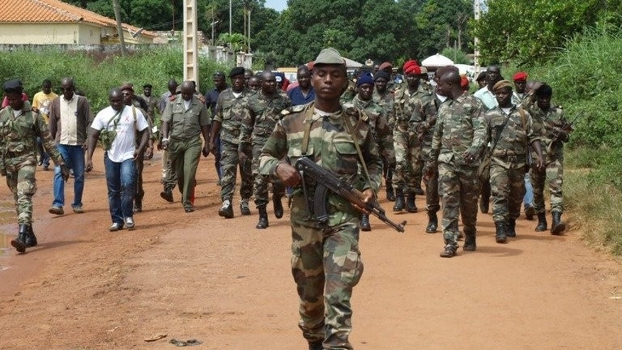 Guinea Bissau soldiers patrol in a street in Bissau last October. Guinea-Bissau opened a new presidential palace Saturday, paid for by China to the tune of $8 million.