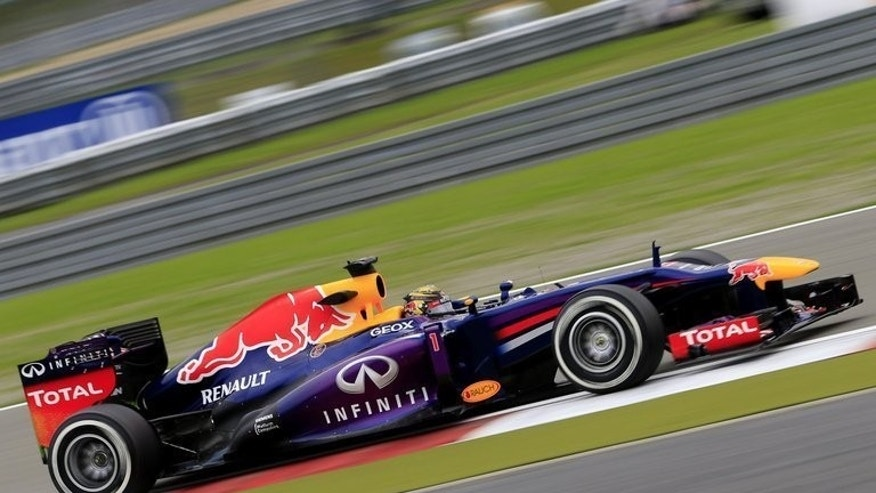 Sebastian Vettel drives in a practice session at the Nurburgring on Friday. Lewis Hamilton clocked a fastest qualifying lap of one minute 29.398 seconds in his Mercedes to outpace nearest rival Vettel by one-tenth of a second in a dramatic finale to a tense hour's action.