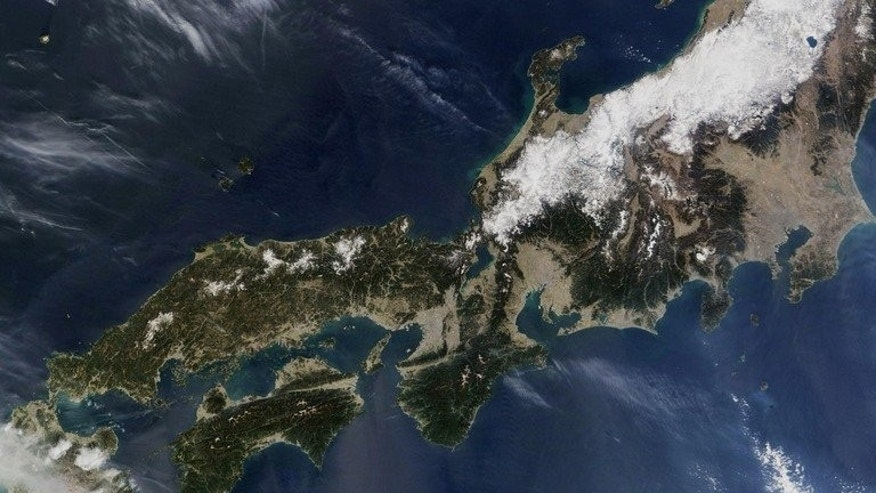 This NASA satellite image shows a portion of Honshu, the main island of Japan, as well as all of Shikoku and most of Kyushu islands, as seen on March 21, 2005. Japan's Cabinet office plans to launch nine satellites in the next five years to counter piracy and monitor the movements of foreign ships intruding into country's territorial waters, according to the business daily Nikkei.