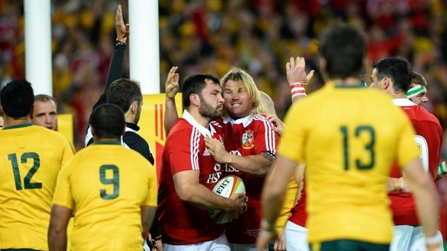 Alex Corbisiero (centre L) is congratulated by Richard Hibbard (centre R) after scoring a try in Sydney on Saturday.