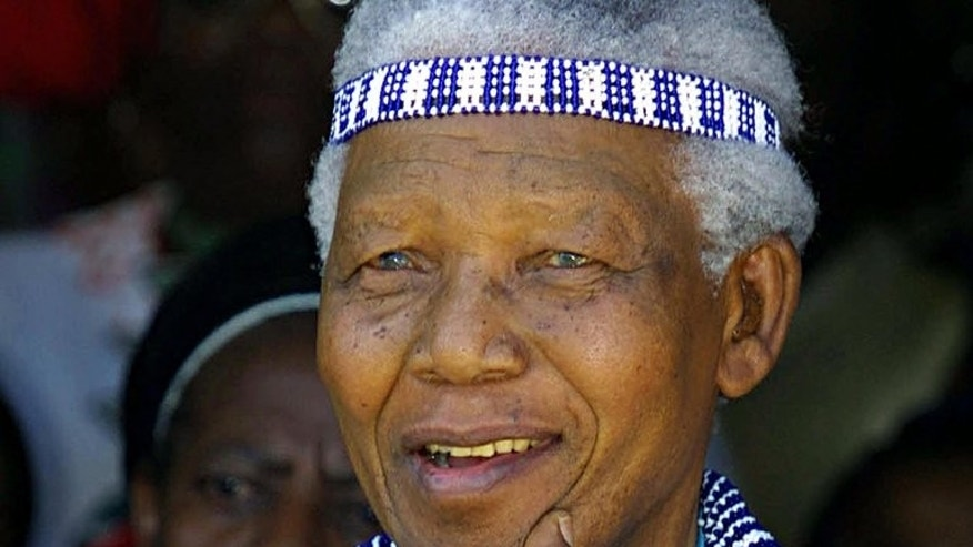 Nelson Mandela at the 2002 wedding of great nephew Prince Mfundo Mtirarar in Umtata, Eastern Cape. A grave-digging dispute has added to the bitter family feuding, over sex, money and power, among Nelson Mandela's heirs which has set South Africans on edge as he lies critically ill in hospital.