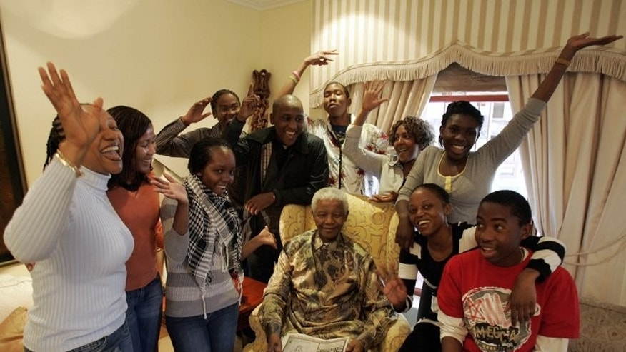 Nelson Mandela (centre) celebrates his 90th birthday with his grandchildren in Qunu, in July 2008. The Nobel peace laureate is famous the world over for spending 27 years in jail and then reconciling with his white oppressors after he became the nation's first black president.
