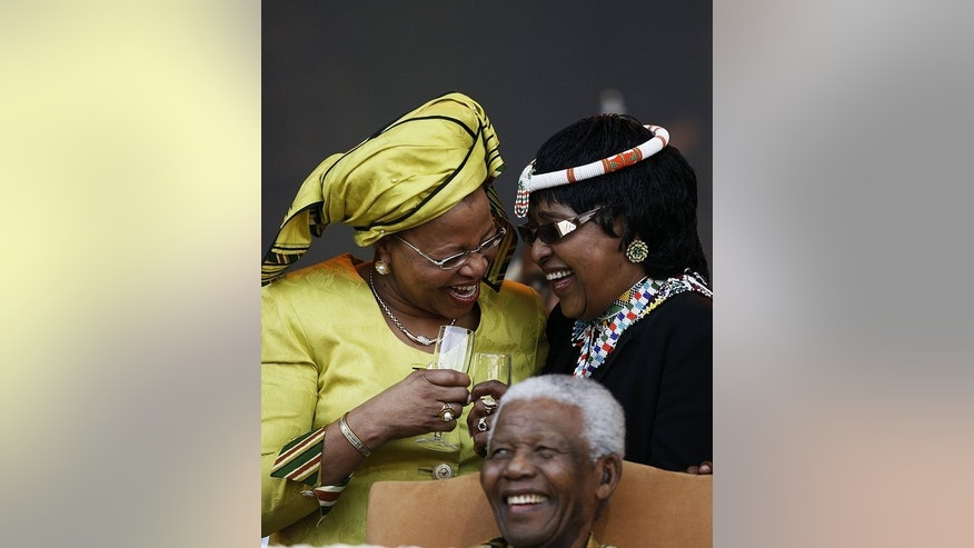 Nelson Mandela with wife Graca Machel (left) and ex-wife Winnie Madikizela Mandela in Pretoria in August 2008. As the 94-year-old Mandela fights for his life, a legal battle among feuding relatives over his eventual resting place has descended into a messy public soap opera.