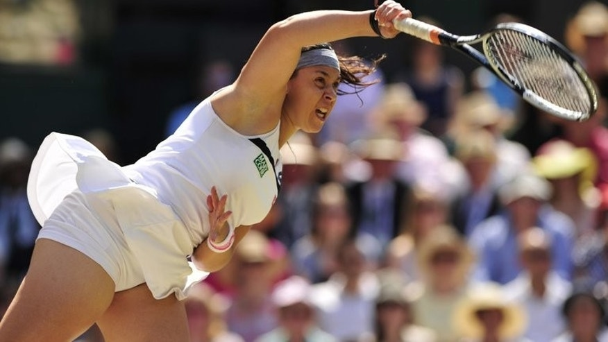 Marion Bartoli serves against Sabine Lisicki at Wimbledon on Saturday. Marion Bartoli romped to her first Grand Slam title as the French 15th seed thrashed Germany's Sabine Lisicki 6-1, 6-4 in the Wimbledon final on Saturday.