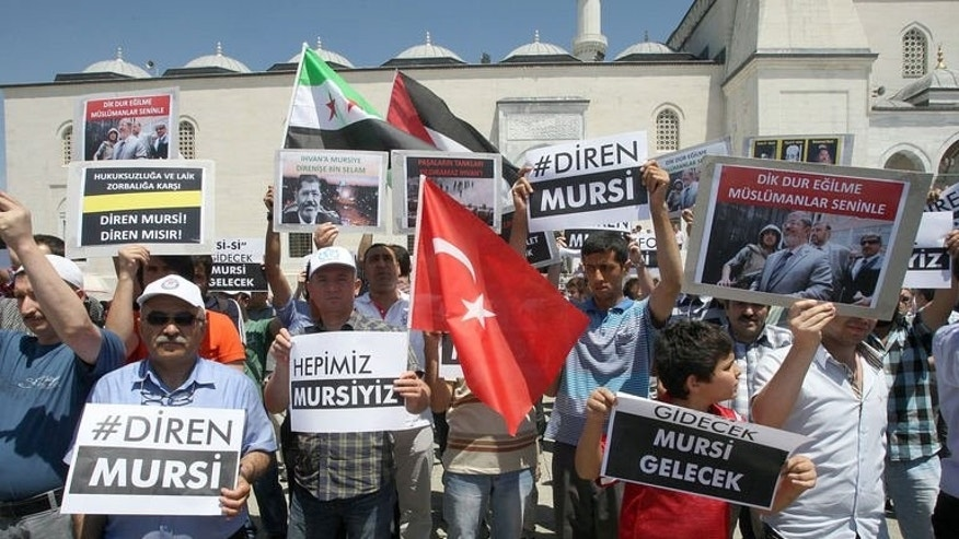 Supporters of unseated Egypt's Islamist president Mohamed Morsi demonstrate outside the Kocatepe Mosque on July 5, 2013 in Ankara.