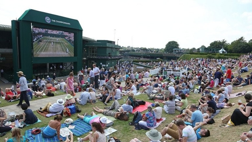 People watch a match on a big screen in Wimbledon, at the All England Lawn Tennis Club, southwest London, on July 6, 2013. Andy Murray tackles world number one Novak Djokovic in Sunday's final, on what will be an emotionally-charged afternoon on Centre Court where 12 months ago the Scot broke down in tears after his loss to Roger Federer.