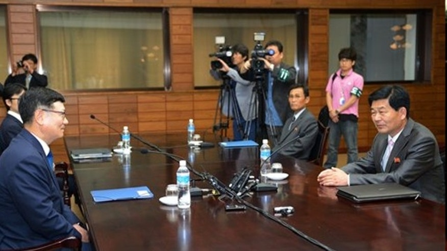 July 6, 2013: Suh Ho, the head of South Korea's working-level delegation, left, talks with his North Korean counterpart Park Chol Su during their meeting at Tongilgak in North Korean side of Panmunjom which has separated the two Koreas since the Korean War.