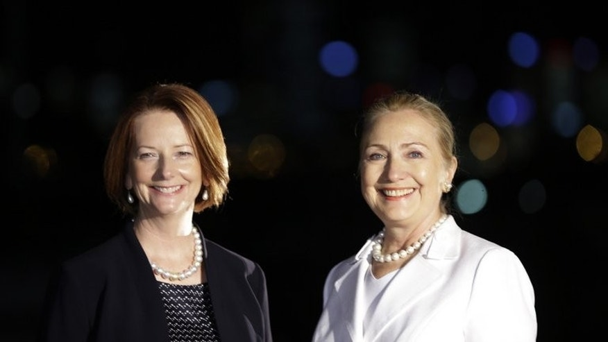 Then Australia's PM Julia Gillard (L) and former US Secretary of State Hillary Clinton pose for photographs before a dinner in Perth, on November 13, 2012. Gillard revealed in a recent interview that she had spoken to Clinton about the travails of female leadership.