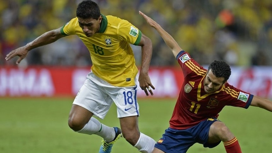 Paulinho (left) clashes with Pedro Rodriguez during the Confederation Cup final in Rio de Janeiro last Sunday. Paulinho joined Tottenham Hotspur on Saturday as the English Premier League club made their first pre-season signing in a bid to secure a top four finish next term.
