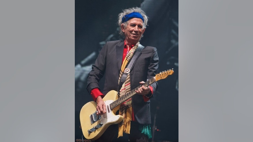 Keith Richards during the Rolling Stones' concert at Glastonbury last weekend. The weather is expected to be as hot as the music when the Stones play London's Hyde Park on Saturday.