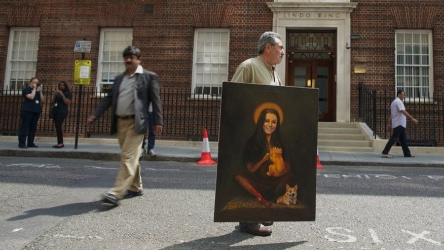 Artist Kaya Mar carries his painting portraying the Duchess of Cambridge with her newly born child and a corgi past the Lindo wing of St Mary's Hospital in London on July 5, 2013. Even before the birth of the new royal baby to Prince William and his wife Kate, genealogists are looking into its family tree, and are coming up with many surprises.