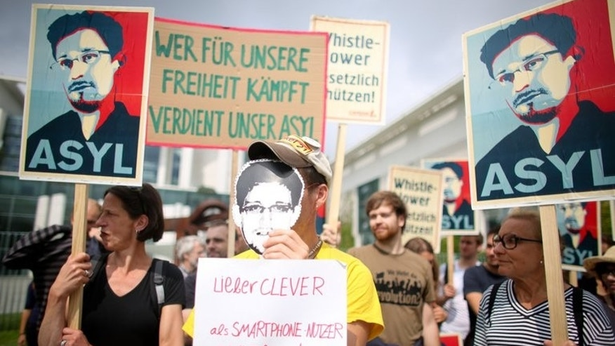 A rally in support of Edward Snowden at the Chancellery in Berlin on Thursday. The US intelligence leaker remained stranded in a Moscow airport for the 14th day Saturday amid rising hopes he may finally be able to leave Russia after being offered asylum by Venezuela.