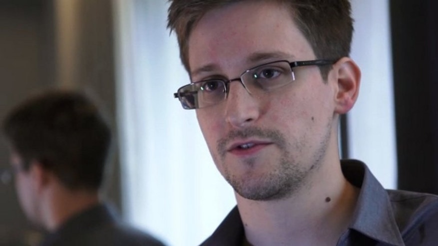 "Edward Snowden speaks during an interview with The Guardian newspaper at an undisclosed location in Hong Kong on June 6, 2013. Venezuelan President Nicolas Maduro offered Friday to give ""humanitarian asylum"" to US intelligence leaker Edward Snowden, who is waiting in a Moscow airport for a nation to give him sanctuary."