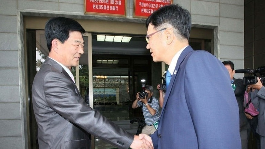 A picture released by South Korea's Unification Ministry, shows Suh Ho (R), head of the S.Korean working-level delegation, meets his N.Korean counterpart Park Chol-Su, in the truce village of Panmunjom, on July 6, 2013. North and South Korea agreed Sunday to inspect a joint industrial zone shuttered amid high cross-border tension and to hold talks on preventing another closure, reports said.