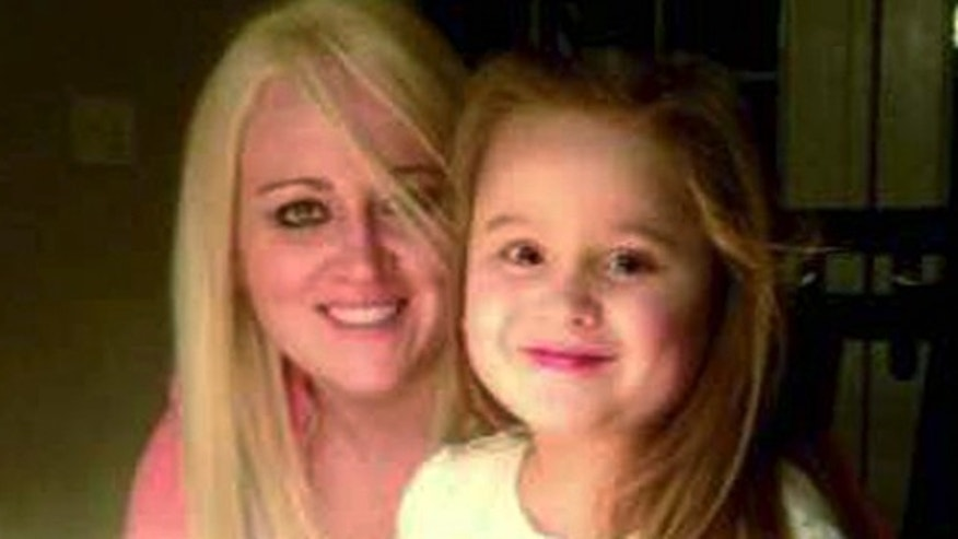 This March 2013 family photo provided by Lindsey DeFilipi shows Shauna Hadden, left, and her daughter Ava Machado, both of Agawam, Mass. Hadden, a Massachusetts mom says she and her 6-year-old daughter are stranded in Brazil after police seized their passports because of a custody battle with the childâs father. (AP Photo/Family Photo)