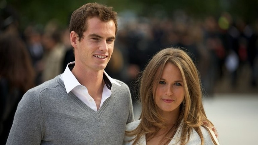 Andy Murray and Kim Sears arrive at the Burberry show in London Fashion Week last September. While Murray and Novak Djokovic slug it out for the Wimbledon title in Sunday's final, their glamourous girlfriends will also be living every moment of the struggle on Centre Centre.