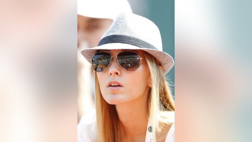 Jelena Ristic watches Noval Djokovic play in the ATP Masters in Monte Carlo in April. Djokovic's girlfriend and Kim Sears, Andy Murray's long-term lover, have emerged as the queens of Centre Court during their partners' dramatic runs to the All England Club title clash.