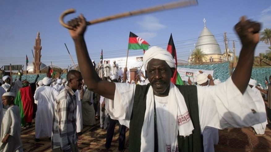 Supporters of Sadiq al-Mahdi rally in Khalifa Square in Khartoum's twin capital of Omdurman on June 29. One year after an eruption of Arab Spring-inspired demonstrations against President Omar al-Bashir's government, the movement has faded but armed rebellion and other challenges have intensified.