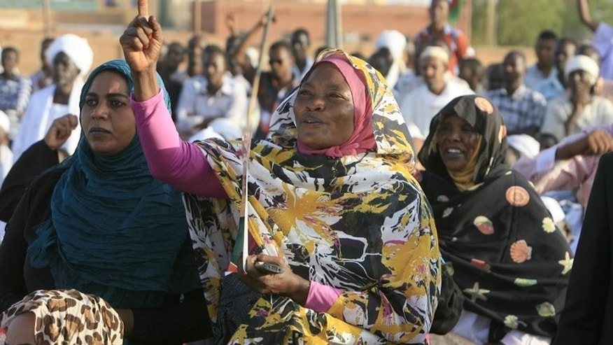 Female supporters of Sadiq al-Mahdi rally in Khalifa Square in Khartoum's twin capital of Omdurman on June 29. Sudan's popular protest movement, however, has not been sustained, in contrast to Arab Spring uprisings against authoritarian leaders in the region, including in next-door Egypt.