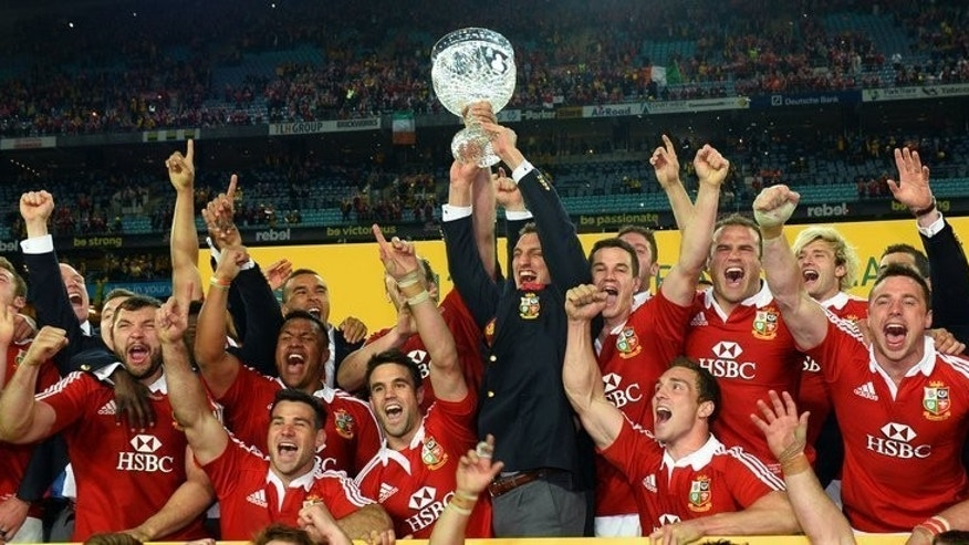 Lions tour captain Sam Warburton holds the trophy after victory in Sydney, on July 6, 2013. The British and Irish Lions thrashed Australia 41-16 as they clinched their first Test series victory in 16 years in record-breaking fashion.