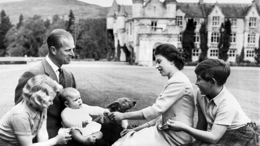 Queen Elizabeth and Prince Philip are shown with three of their children in September, 1960 at Balmoral. The imminent birth of a royal baby will be announced on a golden easel and hailed by cannon fire -- but royal-watchers say that behind the pomp Prince William and Catherine will be trying to balance tradition with modern parenting.