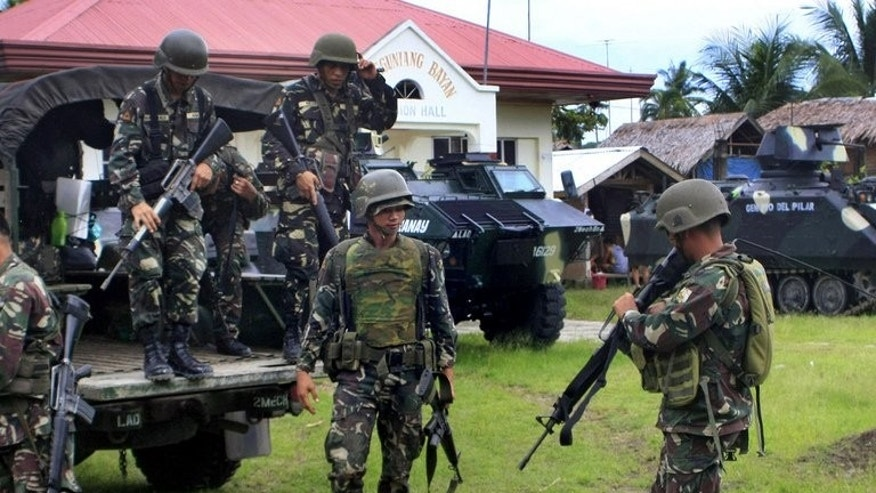Philippine soldiers are seen at a government evacuation center in Datu Piang, Maguindanao province, on August 13, 2011. Five soldiers and three rogue Muslim rebels have been killed in clashes ahead of the resumption of peace talks aimed at ending a decades-old rebellion, the military said on Sunday.