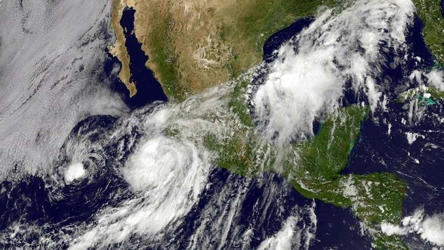 An image obtained from the National Oceanic and Atmospheric Administration shows Hurricane Erick moving up the western coast of Mexico on July 6, 2013. Erick was downgraded to a tropical storm on Sunday after losing some of its punch without having touched land.