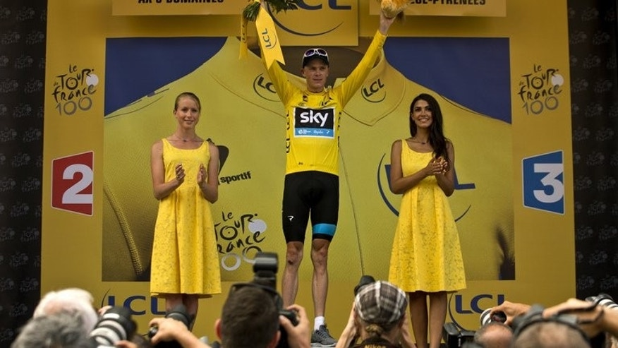Chris Froome celebrates at Ax Trois Domaines on Saturday after donning the Tour de France yellow jersey
