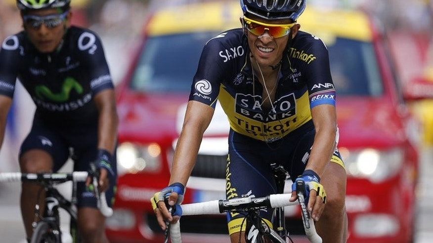 Alberto Contador crosses the finish line of the Tour de France eighth stage at Ax Trois Domaines on Saturday. Unless Contador decides he has to attack and reduce his deficit down to overall leader Froome, Sunday may not turn out to be a decisive day in the general classification.