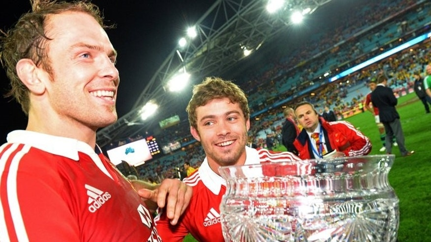 British and Irish Lions captain Alun Wyn Jones (L) and fullback Leigh Halfpenny hold the trophy after the Lions defeated the Australian Wallabies in the third Test match, played in Sydney, on July 6, 2013. Halfpenny bounced back from the anguish of missing a series-clinching kick in the second Test to produce a man of the match performance on Saturday.