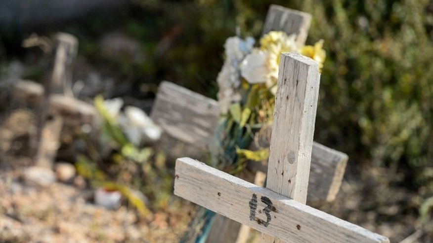 Graves of would-be illegal immigrants who died as they tried to reach Lampedusa are seen in the cemetery of Lampedusa, on July 7, 2013. Lampedusa locals said on Sunday that a surprise visit by Pope Francis made them feel they were no longer alone facing the emergency.