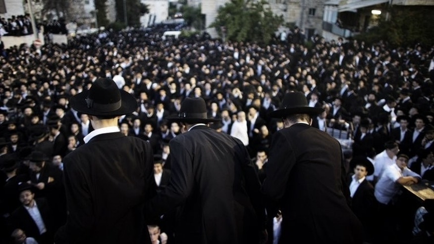 Thousands of ultra-Orthodox Jews gather in front of the main army recruitment office in Jerusalem on May 16, 2013 to demonstrate against any plans to make them undergo military service. The Israeli government on Sunday approved a draft law which will spell the end of a system which has seen tens of thousands of ultra-Orthodox exempt from military service.