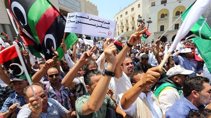 Libyan protesters hold a demonstration demanding the departure of militias on July 7, 2013, in Tripoli. The protesters thronged Algiers Square in the capital from mid-morning to demand the implementation of a General National Congress order for militias to withdraw from the city.
