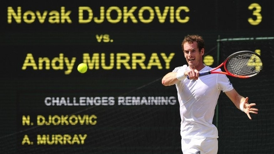 Andy Murray returns against Novak Djokovic at Wimbledon on Sunday. Andy Murray won the first set of the Wimbledon final, 6-4, against Novak Djokovic.
