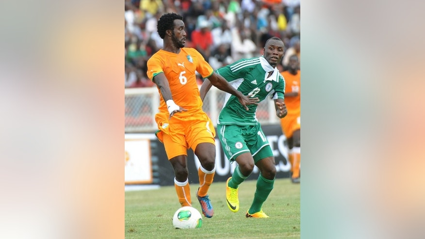 Gambo Mohammed (right) challenges Ivorian defender Baresi Gloudoueu in Kaduna on Saturday. Mohammed was among the scorers as Nigeria won 4-1.