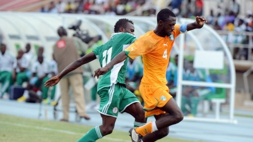 Ivory Coast skipper Marc Goua (right) on the ball against Nigeria in Kaduna on July 6, 2013. The Nigerian 'Super Eagles' are strongly positioned to progress in a competition restricted to footballers playing in their country of birth.