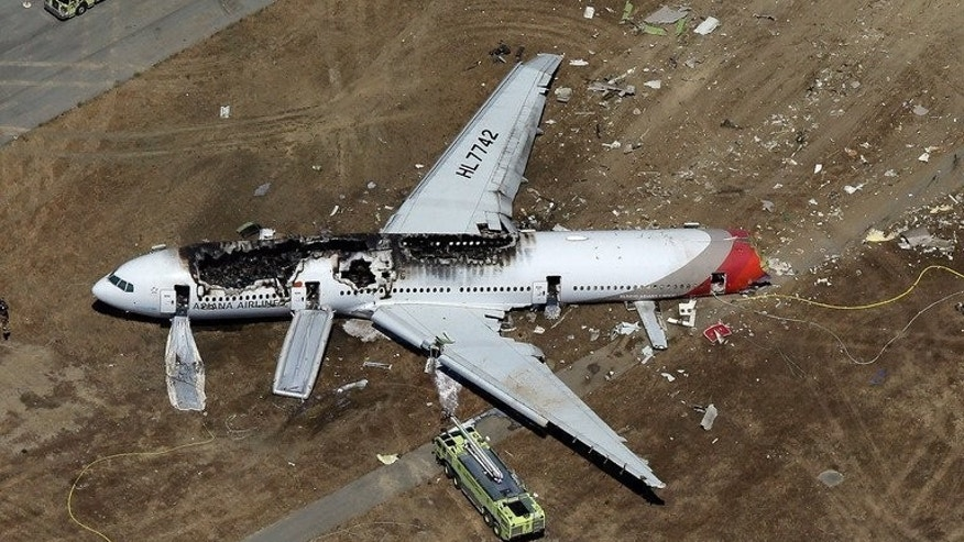 An Asiana Airlines Boeing 777 passenger jet after it crashed at San Francisco, killing two and injuring 182. The plane, which crashed after landing short of the runway was only seven years old and had no known mechanical problems, the Asiana Airlines CEO said.